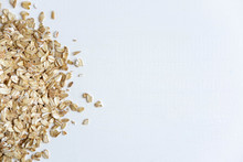 Frame For A Banner With Oatmeal Raw Flakes. Oatmeal And Healthy Food. Diet And Vitamins In Oatmeal