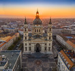 Budapest, Hungary - Aerial view of famous St. Stephen's Basilica in the morning with golden amd blue sky and rising sun at right behind the building