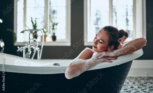 Foto Woman in bathroom