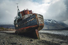 View Of Abandoned Vintage Fishing Boat On Beach Near Corpach Village, Fort William, Scotland, United Kingdom