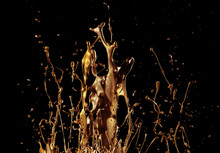 Abstract Golden Liquid Splash On Black Background