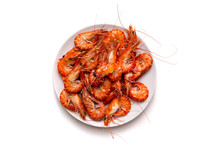 Plate Of Boiled King Prawns On White Isolated Background