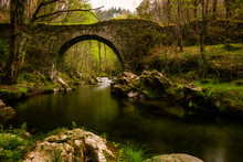 Roman Bridge In Asturias, Spain.