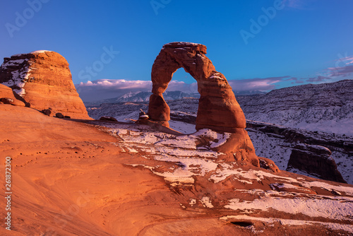 Fotografie, Obraz  Delicate arch a national monument of Utah in rare snow covered conditions inside Arches national park outside of Moab in Utah