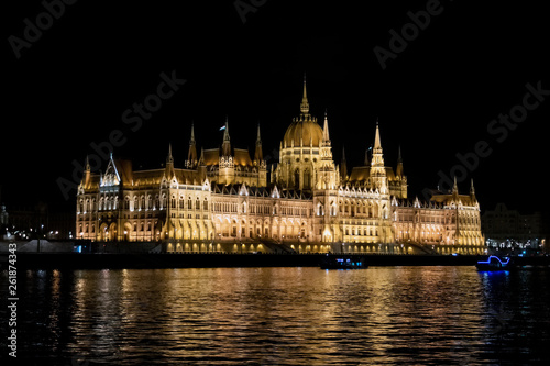 Fotografia  Night view of the Budapest Parliament from the Danube river  in Budapest, Hungar