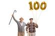 Leinwanddruck Bild - Happy senior men with a golden number hundred balloon