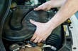 Hands of a car mechanic working in the motor of a car