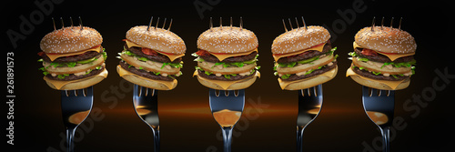 Photo A small hamburger stuck in the fork