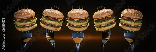 Cuadros en Lienzo A small hamburger stuck in the fork