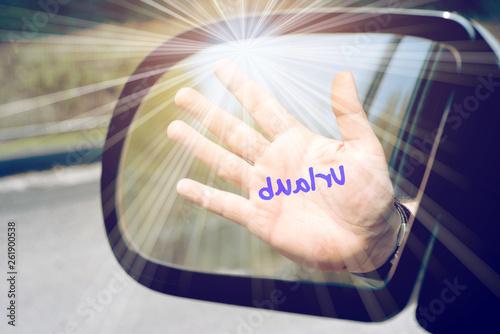 Fotografia, Obraz  Das Wort Urlaub gemalt auf einer Hand