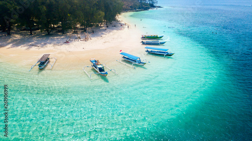 Wooden boats anchored on the Gili Rengit beach