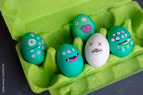 Poster UFO Funny idea for Easter: green eggs in the form of alien monsters with emotions on their faces. Easter decor.