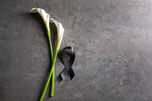 Black Funeral Ribbon And Flowe...
