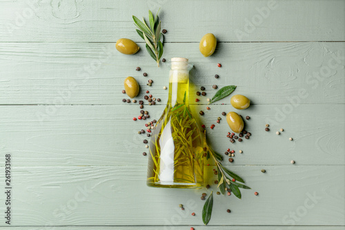 Tablou Canvas Bottle with tasty olive oil on wooden table