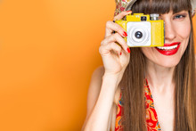 Beautiful Travel Woman With Old Camera Concept Over Colorful Background
