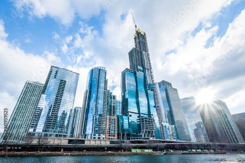 Canvas Prints Light pink Modern tower buildings or skyscrapers in business district, reflection of cloud on sunny day in Chicago, USA. Advanced construction industry, modern company, or real estate project development concept