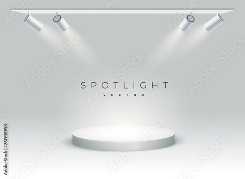 Obraz Five modern spotlights shine on the podium, spot, stage. empty. spotlight shines at an angle on spot. Round podium, pedestal or platform - fototapety do salonu