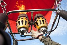 Inflating Of Of Hot Air Balloon. Burners With Flame For Flying