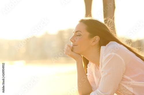 Fotografie, Obraz Relaxed woman enjoying sunset on the beach