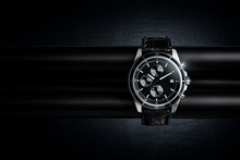 Nice Luxury Man's Wrist Watch On Dark Background. Stainless Steel Man's Wrist Watch With Black Leather Strap.