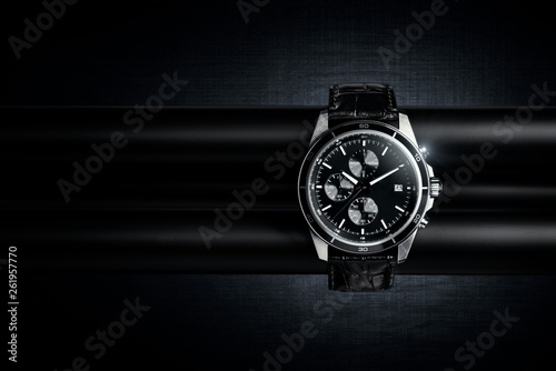 Nice luxury man's wrist watch on dark background Fototapet
