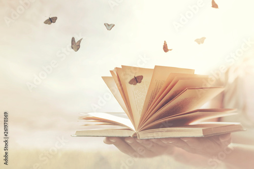 Fototapeta surreal moment of freedom for butterflies coming out of an open book obraz