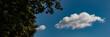Leinwandbild Motiv white clouds on a blue sky background on a sunny day. Web banner.