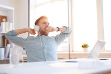 Portrait Of Handsome Businessman Yawning While Sitting At Workplace In Office, Copy Space