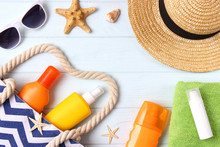 Seashells, Beach Accessories And Sun Protection On A Colored Background Top View. Sunscreen