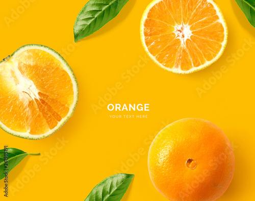 Creative layout made of orange. Flat lay. Food concept. Macro concept. Orange background.