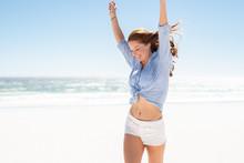 Smiling Woman Enjoying The Beach