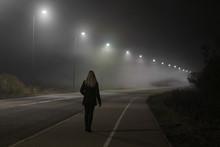 Young Woman Alone Slowly Walki...