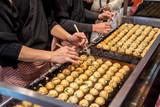 Process to Cooking Takoyaki on hot pan Famous food Osaka Japan street food