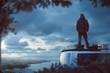 Junger Mann steht auf dem Dach eines Camper Van
