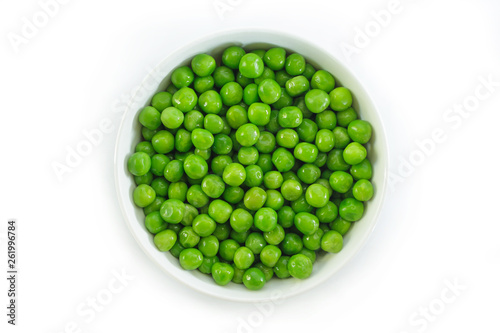 Leinwand Poster green peas on white bowl on white background.