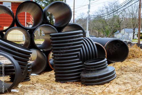 Photo  New gray plastic pipes for the sewage system pipes outdoors