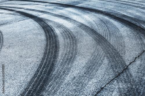 Tire tracks on the asphalt road
