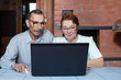 Senior couple and modern technologies. Internet surfing with laptop