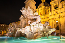 Fountain Of The The Piazza Navona At Night In Rome, Italy