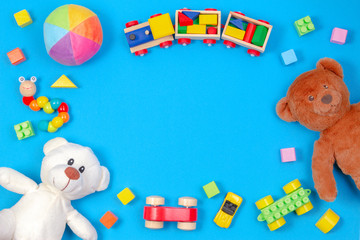 Baby kids toys background. Two teddy bears, wooden train, toy cars, colorful ...