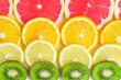 close up of citrus slice, kiwi, oranges and grapefruits isolated on white background. Fruits backdrop, selective focus