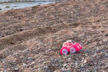 A Toy Car On The Beach