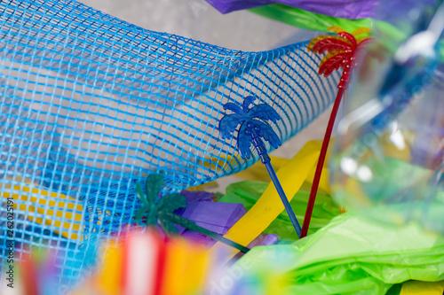 Fotografie, Obraz  Funky colorful skewers in palm form lying on plastic blue net