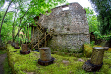 Moss Covered Ancient Mill In O...
