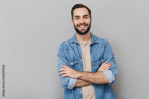 Fotografie, Obraz  Excited cheerful man wearing shirt standing isolated