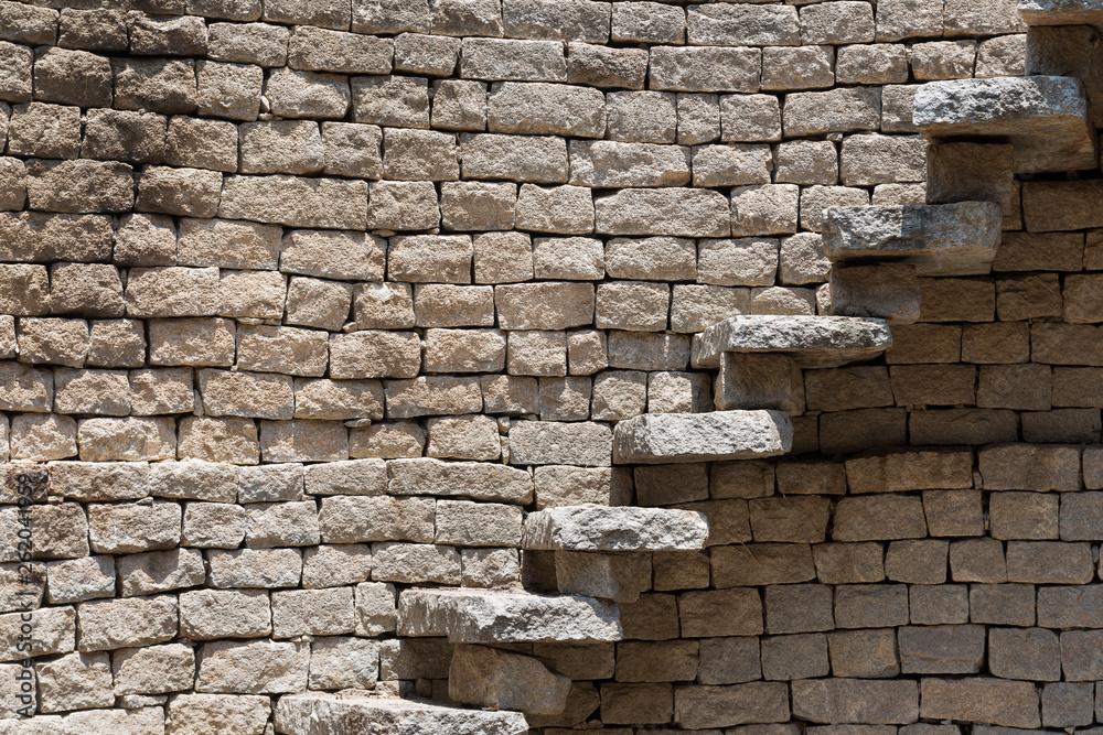Fototapety, obrazy: Stone steps along a wall