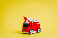 Red Fire Engine On Yellow Background
