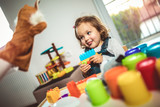 Cute child playing on table indoor, selective focus. - 262049387
