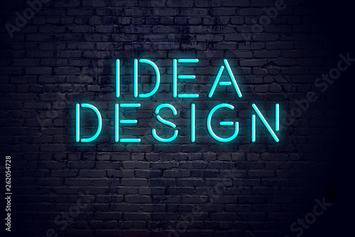 Night view of neon sign with inscription idea design