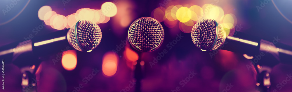 Microphone and stage lights.Concert and music concept.Live music and conference background.Karaoke and entertainment concept.